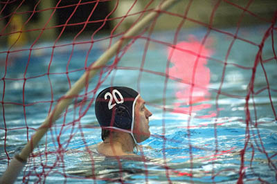 Water polo coach Peter Neirinckx waits for the drop of the ball while playing goalie during practice at the Kroc Center in Coeur d'Alene, Idaho, on Jan. 25, 2016. (Kathy Plonka/The Spokesman-Review/TNS)
