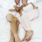 Older-Couple-lying-in-bed-together-50-Plus-Report